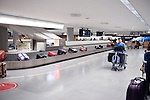 People claiming luggage at Narita International airport baggage conveyor carousel, Japan
