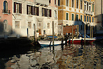 Boats and buildings reflected in water of the Grand Canal. Venice, Italy, May 2005,