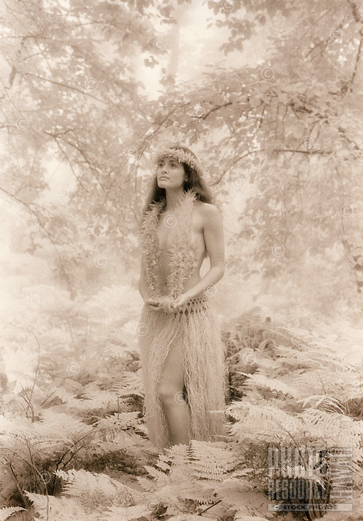 Young Hawaiian girl in the forest near Waimea in the Kohala mountains.