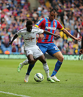 Pictured L-R: Nathan Dyer of Swansea against Marouane Chamakh of Crystal Palace<br />