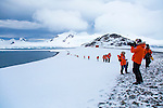 Hiking in the snow on Half Moon Island, home to a large chinstrap penguin colonly, Antarctica