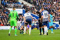 Lewis Dunk of Brighton and Hove Albion receives a yellow card from Referee Jonathan Moss during Brighton & Hove Albion vs Tottenham Hotspur, Premier League Football at the American Express Community Stadium on 5th October 2019