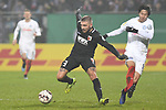 06.02.2019,  GER; DFB Pokal, Holstein Kiel vs FC Augsburg ,DFL REGULATIONS PROHIBIT ANY USE OF PHOTOGRAPHS AS IMAGE SEQUENCES AND/OR QUASI-VIDEO, im Bild Masaya Okugawa (Kiel #11) versucht sich gegen K. Stafylidis (Augsburg #03) durchzusetzenFoto © nordphoto / Witke *** Local Caption ***