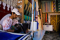 Young Moroccan boys sewing awnings on their machines in the awning manufacture in Marrakech, Morocco, 14 June 2007.