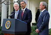 U.S. President Barack Obama (C) makes remarks as former Presidents Bill Clinton (L) and George W. Bush listen after their meeting in the Oval Office, in the  aftermath of the devastating earthquake in Haiti, at the White House in Washington, DC, USA,  16 January 2010.  Obama discussed enlisting the help of the American people to help in the recovery and rebuilding of Haiti. .Credit: Mike Theiler / Pool via CNP