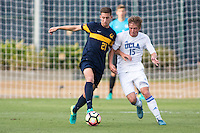 BERKELEY, CA - Oct. 13, 2016: Cal's (21) Joshua Craig Morton hold's off UCLA's (15) Jackson Yueill.  Cal Men's Soccer played UCLA on Goldman Field at Edwards Stadium.