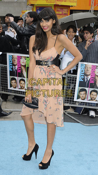 JAMEELA JAMIL.Horrible Bosses UK Premiere, BFI, London, England..20th July 2011.full length pink floral print dress black belt shoes clutch bag hand on hip.CAP/CAN.©Can Nguyen/Capital Pictures.