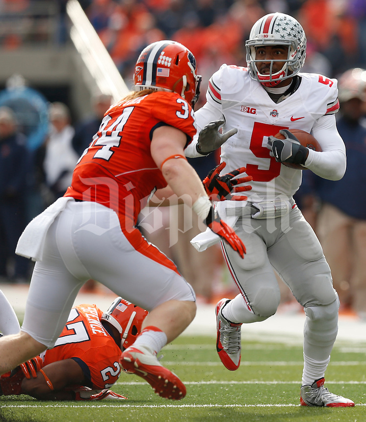 Ohio State Buckeyes quarterback Braxton Miller (5) is pursued by Illinois Fighting Illini linebacker Mike Svetina (34) during the first half of Saturday's NCAA Division I football game at Memorial Stadium in Champaign, Il., on November 16, 2013. Ohio State won the game 60-35. (Barbara J. Perenic/The Columbus Dispatch)