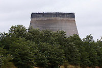 Unfinished cooling tower for reactors 5 and 6 at the Chernobyl Nuclear Power Plant.<br /> Building work was stopped after the disaster at reactor 4 on April 26 1986. The area is today contamined with nuclear material, the half-life of plutonium-239 is more than 24.000 years.<br /> Chernobyl, Ukraine.<br /> August 2008.