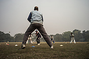 Balram Singh (centre) coaches young cricketers from the Calcutta Parsee Club during their regular practice session at the maidan in Kolkata, West Bengal, India.