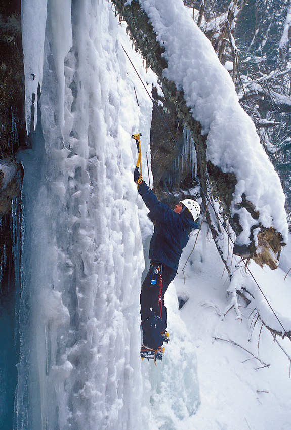 A female ice climber begins a climb on a frozen waterfall at Pictured Rocks National Lakeshore near Munising, Mich.