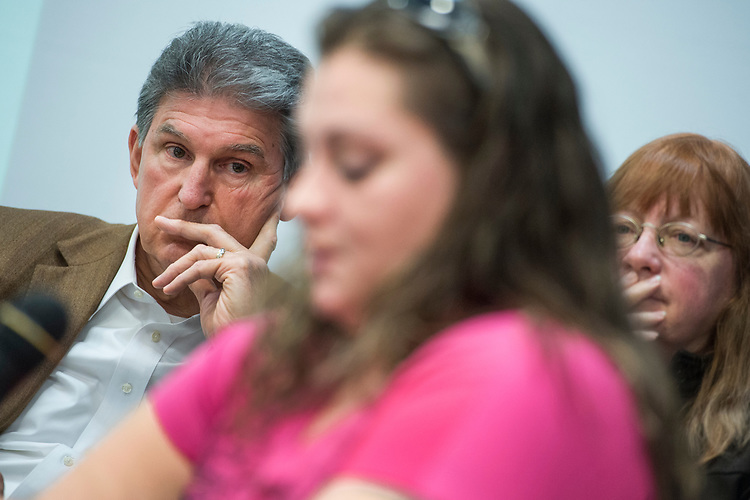 UNITED STATES - MARCH 16: Sen. Joe Manchin, D-W.Va., listens to Diane Hughes share her experience with medical coverage under the Affordable Care Act, during a town hall meeting at the WVU Robert C. Byrd Health Sciences Center in Martinsburg, W.Va., March 16, 2017. Much the discussion was regarding the American Health Care Act, the Republican's plan to repeal and replace the ACA. (Photo By Tom Williams/CQ Roll Call)