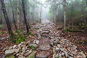 October 2012 - New stonework along the Mt Tecumseh Trail in the White Mountains of New Hampshire on a foggy October day. This photos shows a portion of a stone staircase that is about 150 (+/-) feet long. The staircase continues out of view.