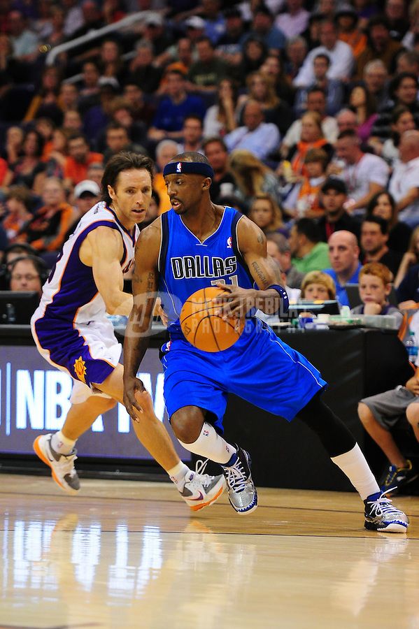 Mar. 27, 2011; Phoenix, AZ, USA; Dallas Mavericks guard (31) Jason Terry against Phoenix Suns guard Steve Nash at the US Airways Center. The Maverick defeated the Suns 91-83. Mandatory Credit: Mark J. Rebilas-
