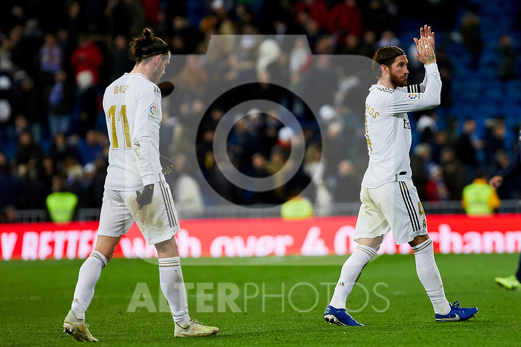 Gareth Bale (L) and Sergio Ramos (R) of Real Madrid celebrate the victory after La Liga match between Real Madrid and Real Sociedad at Santiago Bernabeu Stadium in Madrid, Spain. November 23, 2019. (ALTERPHOTOS/A. Perez Meca)