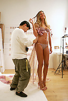 Model Gisele Bundchen is fitted for an upcoming Victoria's Secret Fashion Show at the Victoria's Secret design office in the garment district of Manhattan on Saturday, October 29, 2005.