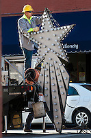 City electric division workers install the Christmas Star above the intersection of State and Main Streets in Uptown Westerville.