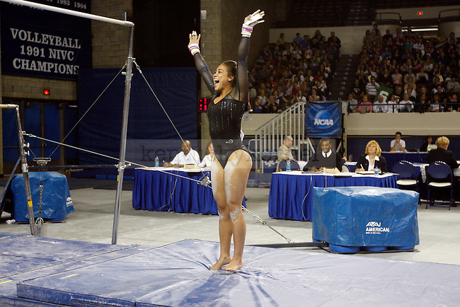Whitney Rose yells in excitement after her uneven bars performance at the women's gymnastics SEC tournament on  Saturday, April 10, 2010. Photo by Britney McIntosh | Staff