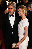 HOLLYWOOD, LOS ANGELES, CA, USA - MARCH 02: Harrison Ford, Calista Flockhart at the 86th Annual Academy Awards held at Dolby Theatre on March 2, 2014 in Hollywood, Los Angeles, California, United States. (Photo by Xavier Collin/Celebrity Monitor)