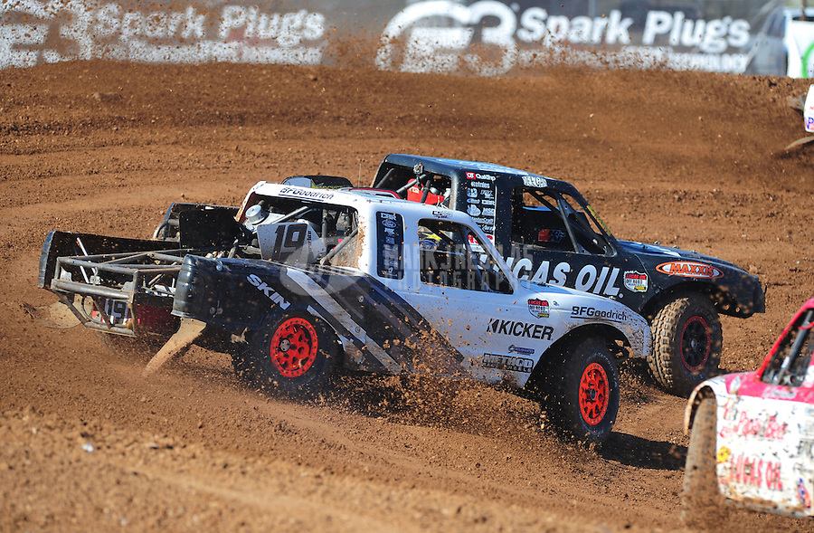 Apr 16, 2011; Surprise, AZ USA; LOORRS driver Brian Deegan (38) leads Corey Sisler (19) during round 3 at Speedworld Off Road Park. Mandatory Credit: Mark J. Rebilas-.