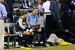 18 October 2012: UNC goalkeeper coach Chris Ducar (right) talks to Adelaide Gay (33) on the bench at halftime. The University of North Carolina Tar Heels defeated the Duke University Blue Devils 2-0 at Koskinen Stadium in Durham, North Carolina in a 2012 NCAA Division I Women's Soccer game.