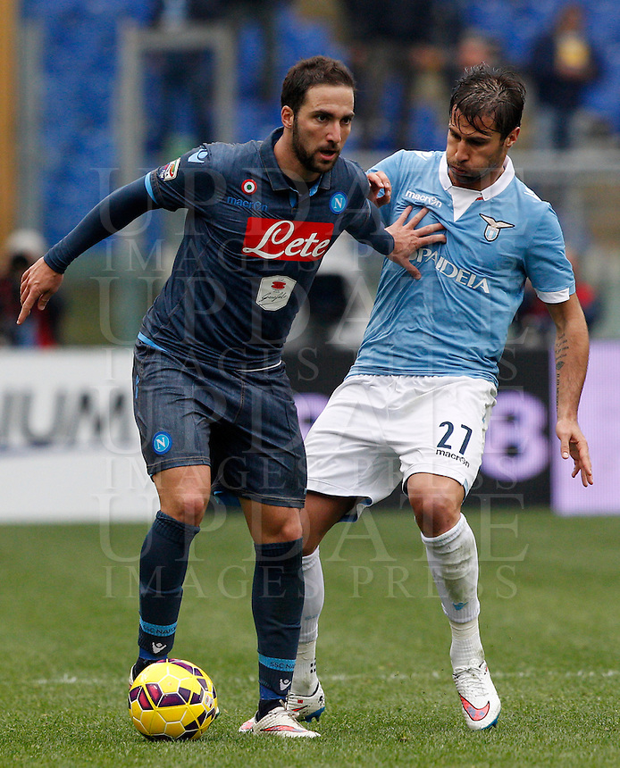 Calcio, Serie A: Lazio vs Napoli. Roma, stadio Olimpico, 18 gennaio 2015.<br /> Napoli&rsquo;s Gonzalo Higuain is challenged by Lazio&rsquo;s Lorik Cana, right, during the Italian Serie A football match between Lazio and Napoli at Rome's Olympic stadium, 18 January 2015.<br /> UPDATE IMAGES PRESS/Riccardo De Luca