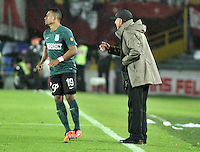 BOGOTA - COLOMBIA -27 -01-2015: Juan C Osorio, tecnico de Atletico Nacional da instrucciones a Farid Diaz durante partido de vuelta entre Independiente Santa Fe y Atletico Nacional por la Super Liga 2015, en el estadio Nemesio Camacho El Campin de la ciudad de Bogota.  / Juan C Osorio, coach of Atletico Nacional, gives instructions to Farid Diaz during the match between Independiente Santa Fe and Atletico for the second leg of the Super Liga 2015 at the Nemesio Camacho El Campin Stadium in Bogota city. Photo: VizzorImage / Luis Ramirez / Staff.