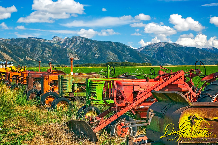 Old tractors doubling as farm art in Star Valley Wyoming.