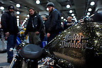 New york, United States. 18th January 2013 -- People look at Harley Davidson motorcycles during The International Motorcycle Show in New York. BMW, Ducati, Harley-Davidson, Honda, Kawasaki, Suzuki, Star, Triumph, Victory, Yamaha and more have all utilized the International Motorcycle Shows to unveil new motorcycles and concept vehicles to the world. Photo by Eduardo Munoz Alvarez / VIEWpress.