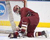 Andrew Orpik helps gather the pucks at the end of practice - The Boston College Eagles took their morning skate on Saturday, April 8, 2006, at the Bradley Center in Milwaukee, Wisconsin to prepare for the 2006 Frozen Four Final game versus the University of Wisconsin.