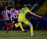 Lincoln City's Tom Pett is fouled by Cheltenham Town's William Boyle<br /> <br /> Photographer Chris Vaughan/CameraSport<br /> <br /> The EFL Sky Bet League Two - Lincoln City v Cheltenham Town - Tuesday 13th February 2018 - Sincil Bank - Lincoln<br /> <br /> World Copyright &copy; 2018 CameraSport. All rights reserved. 43 Linden Ave. Countesthorpe. Leicester. England. LE8 5PG - Tel: +44 (0) 116 277 4147 - admin@camerasport.com - www.camerasport.com