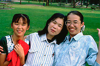 Japanese dance students ages 10 and 25 picnicking at Como Park.  St Paul Minnesota USA