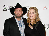 LOS ANGELES, CA - FEBRUARY 08: Garth Brooks and Trisha Yearwood at the MusiCares Person of the Year Tribute held at Los Angeles Convention Center, West Hall on February 8, 2019 in Los Angeles, California. <br /> CAP/MPI/IS/CSH<br /> &copy;CSHIS/MPI/Capital Pictures