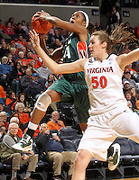 Jan. 6, 2011; Charlottesville, VA, USA; Miami Hurricanes forward Sylvia Bullock (34) shoots the basket next to Virginia Cavaliers forward Chelsea Shine (50) during the game at the John Paul Jones Arena.  Mandatory Credit: Andrew Shurtleff-