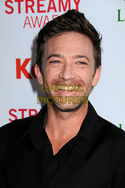 DAVID FAUSTINO.The 2nd Annual Streamy Awards held at the Orpheum Theatre, Los Angeles, California, USA, 11th April 2010 .portrait headshot stubble facial hair  black shirt smiling .CAP/ADM/BP.©Byron Purvis/AdMedia/Capital Pictures.
