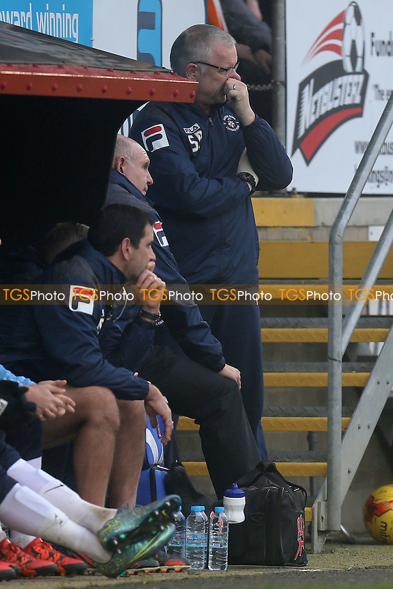 Luton Town manager John Still is treated by the Club doctor for 5 minutes during Dagenham and Redbridge vs Luton Town at the Chigwell Construction Stadium
