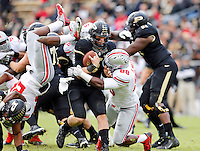 Ohio State Buckeyes defensive lineman Steve Miller (88) sacks Purdue Boilermakers quarterback Danny Etling (5) during the fourth quarter of the NCAA football game at Ross-Ade Stadium in West Lafayette, Ind. on Nov. 2, 2013. (Adam Cairns / The Columbus Dispatch)