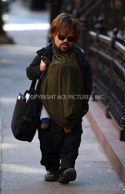 WWW.ACEPIXS.COM . . . . .  ....February 13 2012, New York City....Golden Globe-winning actor Peter Dinklage takes his baby daughter for a stroll in the West Village on February 13 2012 in New York City....Please byline: PHILIP VAUGHAN - ACE PICTURES.... *** ***..Ace Pictures, Inc:  ..Philip Vaughan (212) 243-8787 or (646) 769 0430..e-mail: info@acepixs.com..web: http://www.acepixs.com