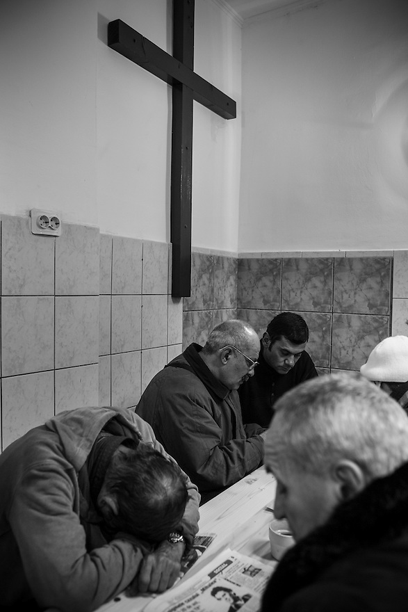 Pastor Lucas Rahanar, center, leads bible study at Victory Outreach, a soup kitchen and shelter for the homeless in Bucharest.