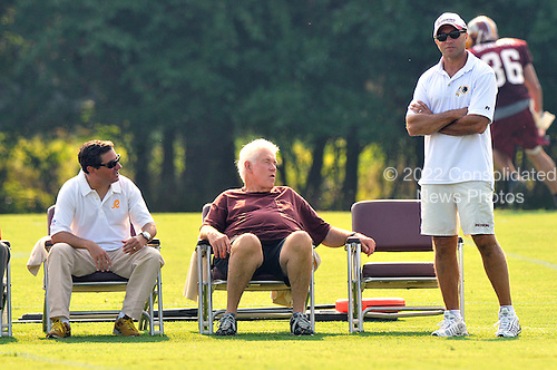Ashburn, VA - July 20, 2008 -- Washington Redskins owner Dan Snyder, left, former assistant coach Don Breaux, center, and Executive Vice President for Football Operations Vinny Cerrato, right, share some thoughts as they watch the first morning session of the 2008 Washington Redskins training camp at Redskins Park in Ashburn Virginia on Sunday, July 20, 2008..Credit: Ron Sachs / CNP