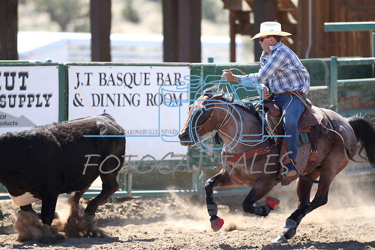 Clint Grimes competes in the ranch horse class slack event at the Minden Ranch Rodeo on Saturday, July 23, 2011, in Gardnerville, Nev. .Photo by Cathleen Allison