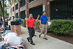 Rick Moreci, Director of Housing Services, show DePaul President A. Gabriel Esteban, Ph.D., around the dorms during Move In Day. Photo by Diane M. Smutny