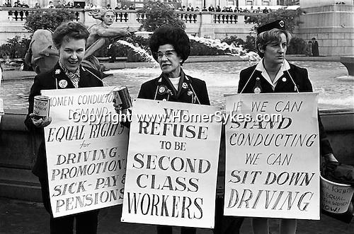 Womens Rights. Equal Pay for Women. Rally Trafalgar Square central London England 1968. Women bus conductors with placards at a protest in 1968 to demand equal rights with men at work.