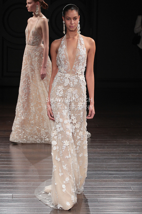 Model walks runway in a St. Lucia bridal gown from the Naeem Khan Bridal Spring 2017 collection at 260 West 36 Street, during New York Bridal Fashion Week Spring Summer 2017 on April 16, 2016.