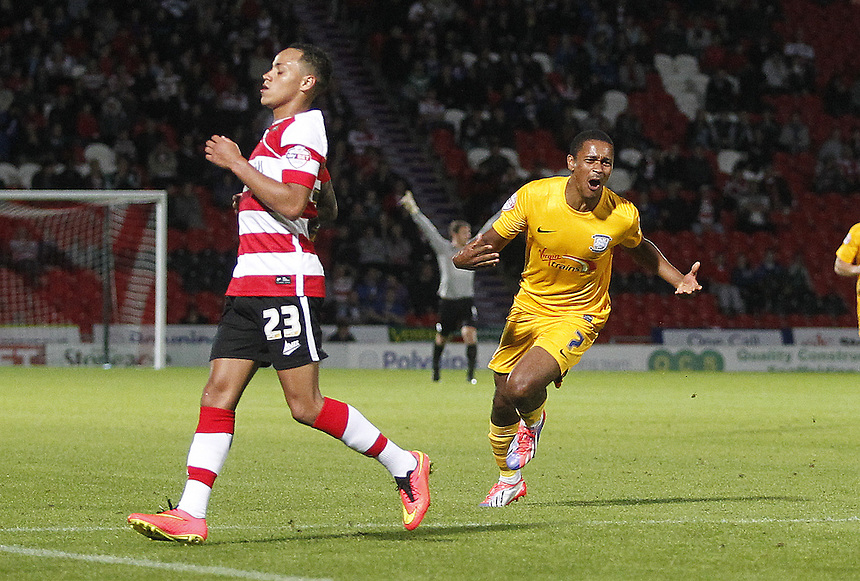 Preston North End's Chris Humphrey celebrates scoring his sides first goal  as Doncaster Rovers' Kyle Bennett dispairs<br /> <br /> Photographer Mick Walker/CameraSport<br /> <br /> Football - The Football League Sky Bet League One - Doncaster Rovers v Preston North End - Tuesday 19th Auguest 2014 - Keepmoat Stadium - Doncaster<br /> <br /> &copy; CameraSport - 43 Linden Ave. Countesthorpe. Leicester. England. LE8 5PG - Tel: +44 (0) 116 277 4147 - admin@camerasport.com - www.camerasport.com