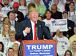 3/7/2016 Madison,Mississippi On the eve of the Mississippi Presidential Primary Presidential Republican candidate Donald J. Trump stumps to a crowd of Southern voters at Madison Central High School gymnasium. Trump asks the audience to raise their right hands and pledge to vote for him in the primary. Trump spoke about making America great again as Black Lives Matter protestors demonstrated outside. Photo ©Suzi Altman