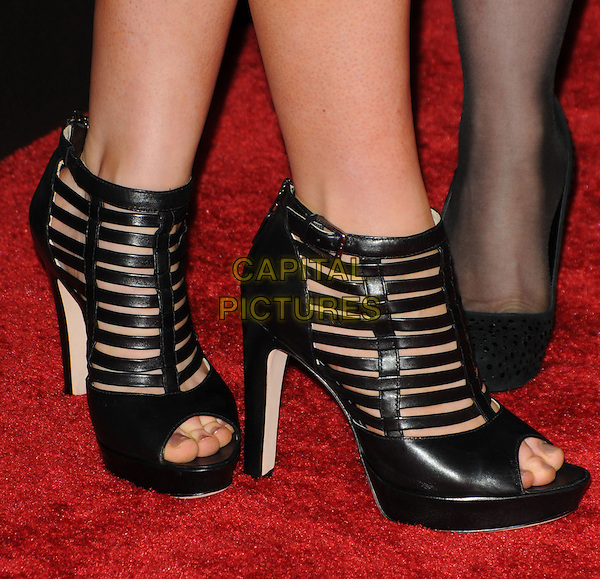 ANNA PAQUIN's shoes.The 12th Annual Costume Designers Guild Awards held at The Beverly Hilton Hotel in Beverly Hills, California, USA. .February 25th, 2010 .platform strappy ankle sandals shoes black cage booties.CAP/RKE/DVS.©DVS/RockinExposures/Capital Pictures.