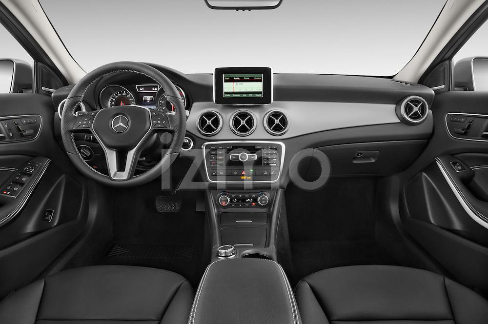 Stock photo of straight dashboard view of2015 Mercedes Benz GLA 250 4Matic Exclusiefpakket 5 Door SUV Dashboard