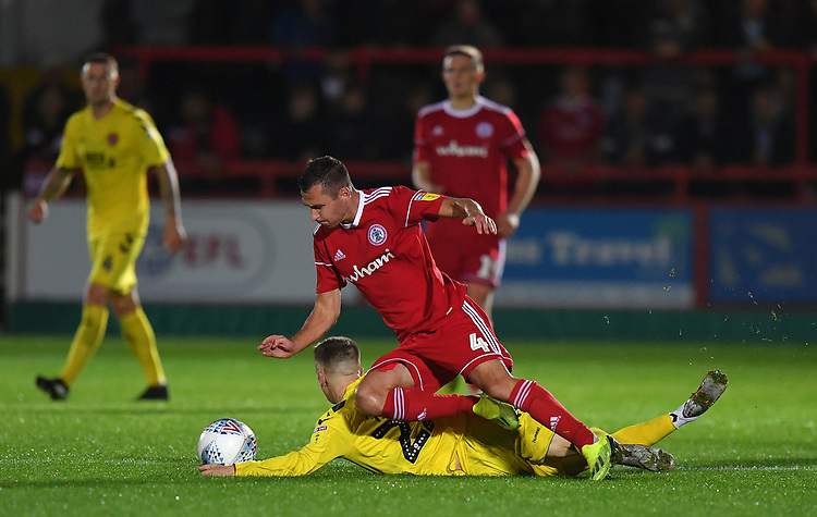 Fleetwood Town's Ashley Hunter is fouled by  Accrington Stanley's Phil Edwards<br /> <br /> Photographer Dave Howarth/CameraSport<br /> <br /> EFL Leasing.com Trophy - Northern Section - Group B - Tuesday 3rd September 2019 - Accrington Stanley v Fleetwood Town - Crown Ground - Accrington<br />  <br /> World Copyright © 2019 CameraSport. All rights reserved. 43 Linden Ave. Countesthorpe. Leicester. England. LE8 5PG - Tel: +44 (0) 116 277 4147 - admin@camerasport.com - www.camerasport.com