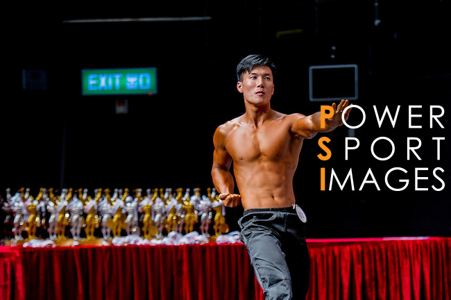 A bodybuilder competes in the South China Men's Fitness Physique category during the 2016 Hong Kong Bodybuilding Championships on 12 June 2016 at Queen Elizabeth Stadium, Hong Kong, China. Photo by Lucas Schifres / Power Sport Images